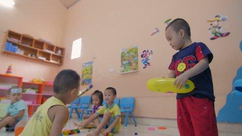 HANOI, VIET NAM - CIRCA JULY 2016: Showing special needs school kids in a kindergarten facility