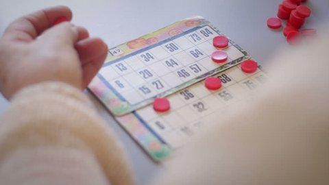 Old woman's hands playing bingo
