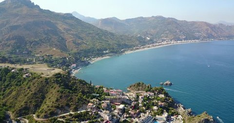 Aerial drone footage of panoramic view of Taormina in Sicily, Italy
