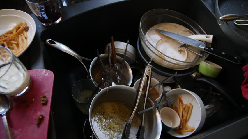 DISGUSTING PILE OF DIRTY DISHES.  Slow, close up dolly move across a pile of dirty dishes in the kitchen sink.Originally shot in 4K, 10 bit. | Shutterstock HD Video #28033465