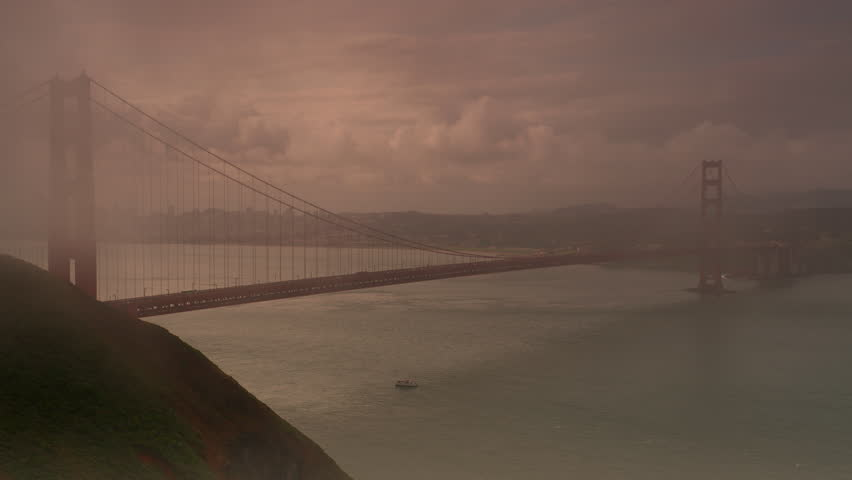 Golden Gate Bridge with fog rolling past. 4K