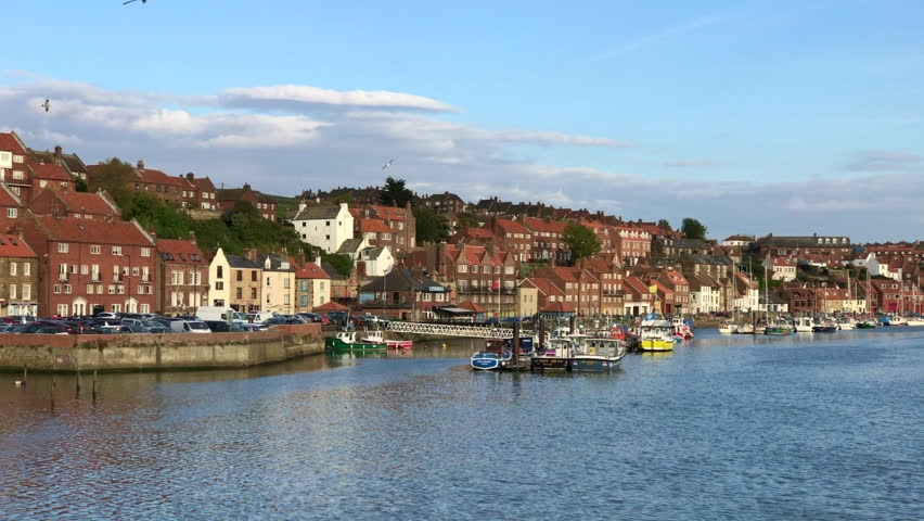 WHITBY, ENGLAND - MAY 13: Warm evening sunlight on boats in Whitby harbour. In Whitby, North Yorkshire, England. On 13th May 2017. | Shutterstock HD Video #28080628