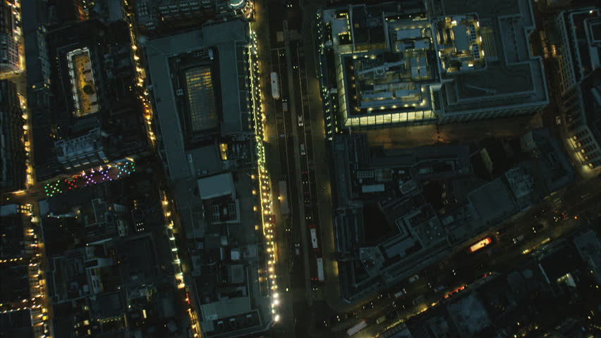 Aerial view at night of illuminated rooftops and commuter traffic in Regent Street London UK RED DRAGON