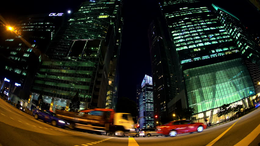 Singapore - September 2016: Fish Eye view at night of illuminated Skyscraper buildings in Central Downtown vehicle traffic people crossing at city crosswalk intersection South East Asia #28094488
