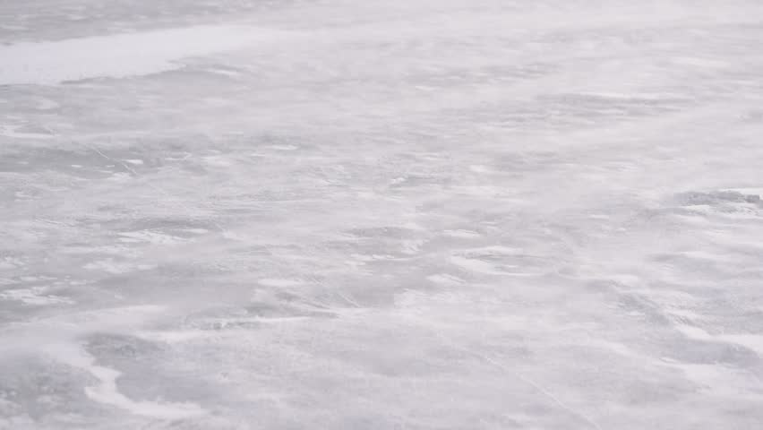 Drift snow on ice in winter blown diagonally by heavy wind | Shutterstock HD Video #28094878