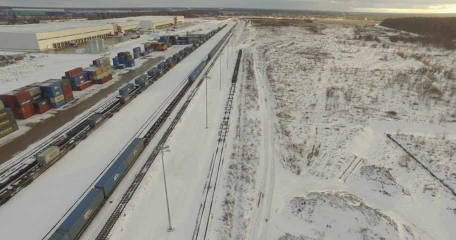 Railroad track top view. Aerial view of empty railroad in winter time. Flying over countryside on a cold snowy winter day. Freight and logistics concept. #28095628