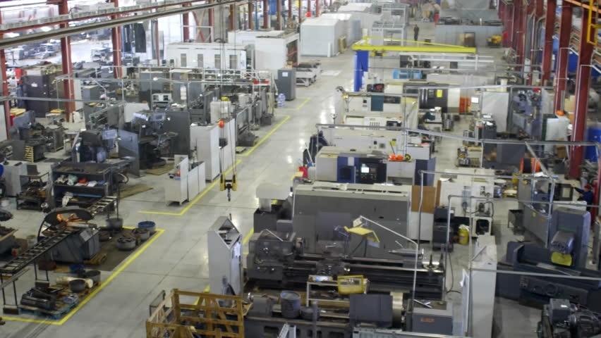 PAN of industrial interior of production department in compressor plant. High angle view