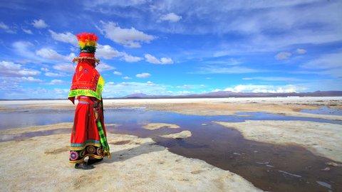 Latin American Indigenous women in traditional National Headdress and costume on Salar de Uyuni Bolivian Salt flats