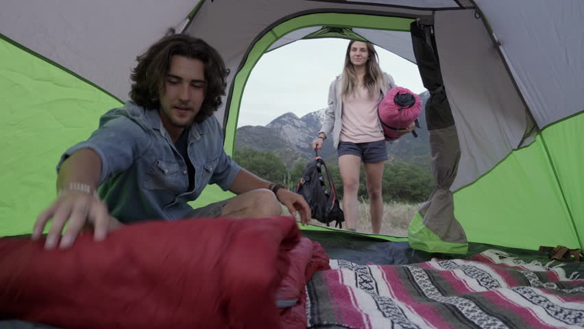 Man Unrolls His Sleeping Bag Inside Tent Girlfriend Comes Gives Him A