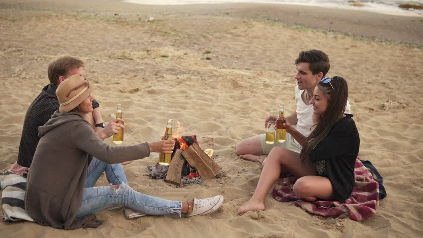 Superieur Group Of Young People Toasting With Beer Bottles And Having A Beach Party  On A Summer