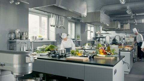 Time-Lapse Panoramic Shot of Big Restaurant Kitchen and Three Chefs Working. Shot on RED EPIC-W 8K Helium Cinema Camera.