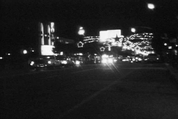 HOLLYWOOD CALIFORNIA - DECEMBER 2:  Vintage super 8 night time lapse  footage of Christmas holiday lights and traffic on December 2, 1986 in Hollywood, California.