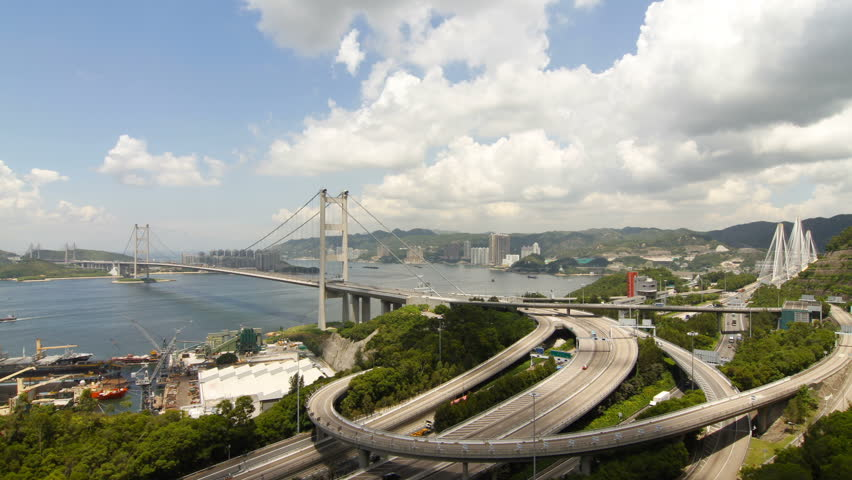 Time lapse of Tsing Ma Bridge at Summer - Tsing Ma Bridge is a bridge in Hong Kong. It is the world's seventh-longest span suspension bridge.   Shutterstock HD Video #2824708