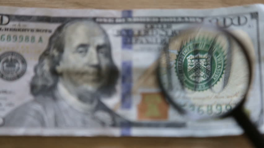 Checking a bank note   Shutterstock HD Video #28248778