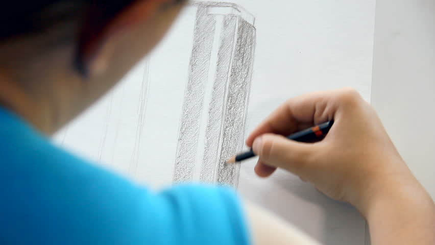 Drawing a business skyscraper with pencil and without other tools. Young woman wanted to be an architect.