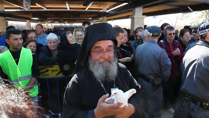QASR AL YAHUD, ISRAEL – JANUARY 18: Greek Orthodox pilgrims wait for baptism during the Epiphany at Qasr Al Yahud, Israel, January 18 2012