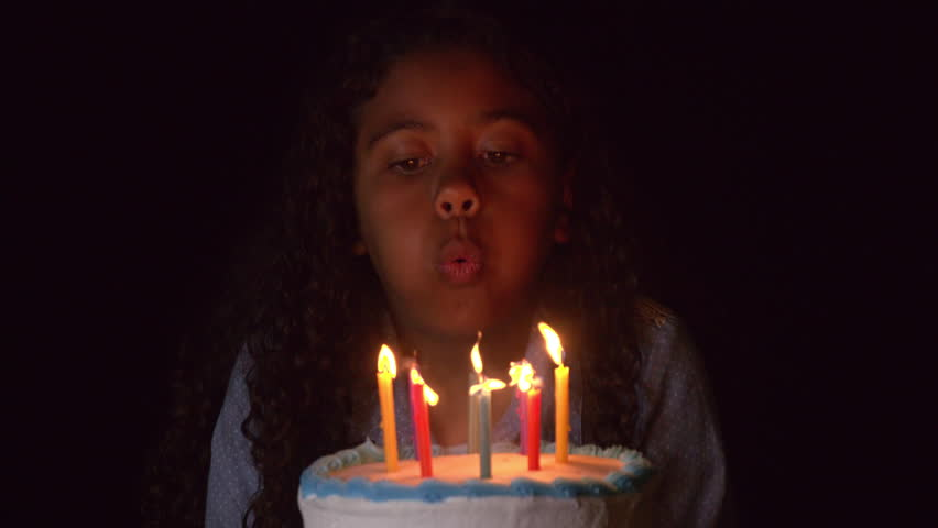 Cute Girl Blows Out The Candles On Her Birthday Cake