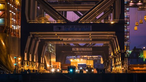 PORT OF FELIXSTOWE UK - CIRCA 2017: unloading sea containers at busy port