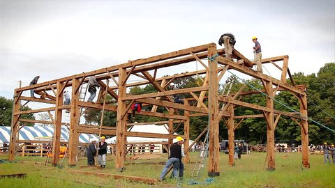 WATERLOO, ONTARIO - SEPTEMBER 21: Local Amish people traditionally raise a barn on September 21, 2012 in Waterloo, Ontario. This is a time lapse of a purlin being erected into place.