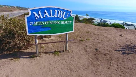 World famous Malibu landmark sign shot by drone in 4K. Beautiful aerial views, low to high, revealing gorgeous Pacific Ocean, Pacific Coast Highway and Malibu, California. Terrific for b-roll clips...