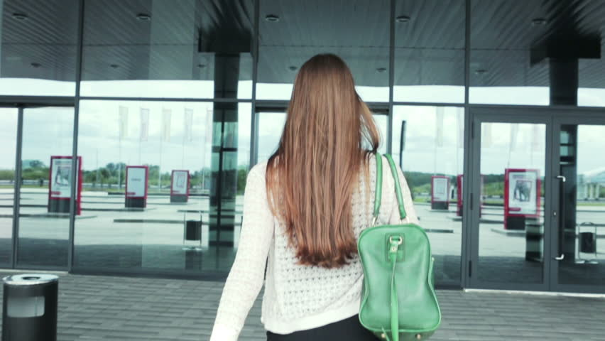 Girl Walks Into Door : Backlit businessman and woman meet against a backdrop of
