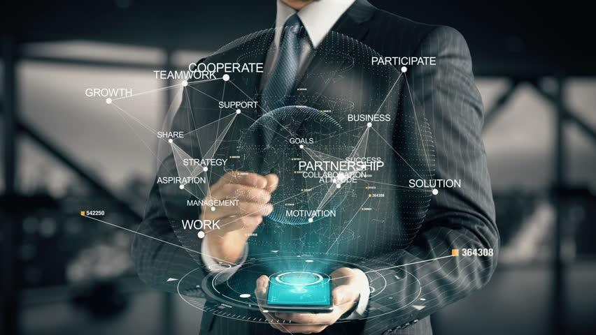 Businessman with Partnership hologram concept | Shutterstock HD Video #28335943