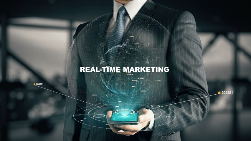 Businessman with Real-Time Marketing hologram concept
