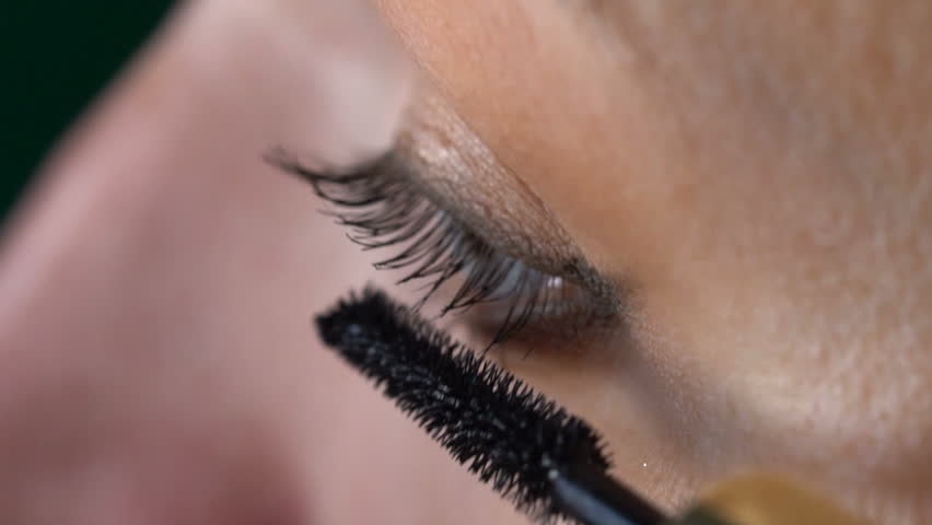 Closeup of woman's eye applying mascara - video in slow motion