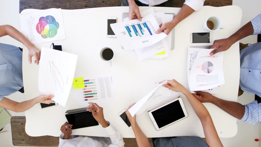 Business people at a desk passing documents, overhead shot   Shutterstock HD Video #28384888