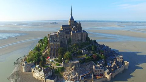 Aerial view of Mont Saint Michel, iconic island and monastery at twilight, Normandy, France, 4k UHD