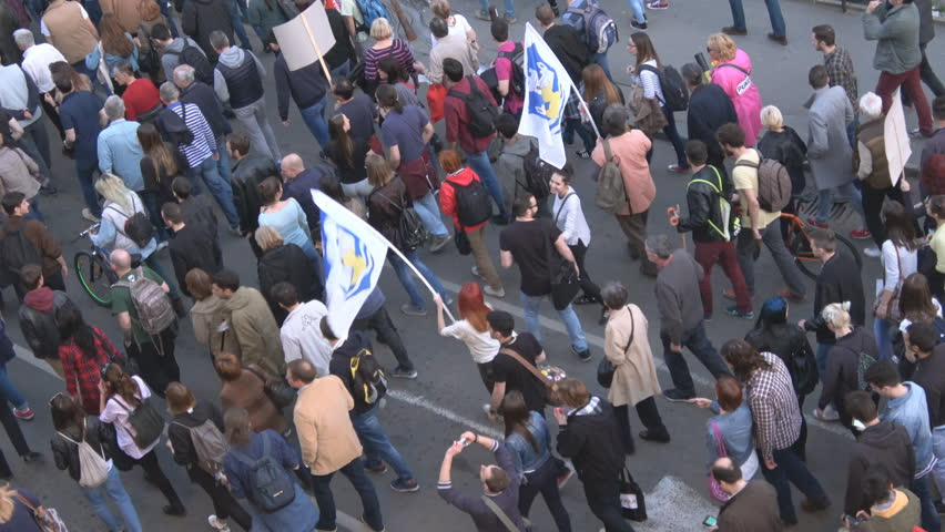 People walking Student protest rally in Belgrade ,Serbia 04/25/2017,Aerial Handheld camera Balanced Steady shot  #28423408