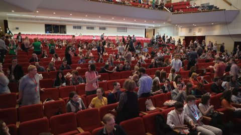 Novosibirsk Russia - May 20 2017: Listeners on learning conference or culture show. Leisure or convention for satisfaction and discussion. Big crowd enters hall and takes places. All seats are busy