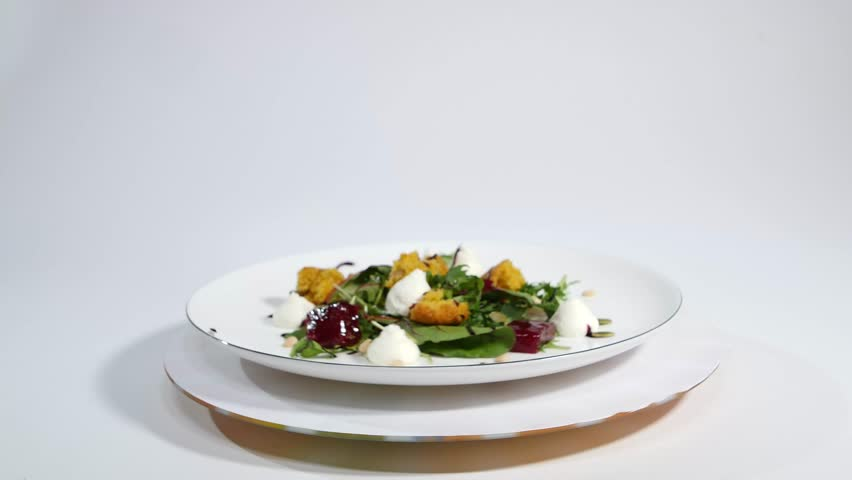 Salad with herring, beetroot, paprika, red onion, mustard and balsamic vinegar. Salad of lettuce, beetroot and salmon fillets with a delicate cream sauce. Salad with greens, fish and beetroot