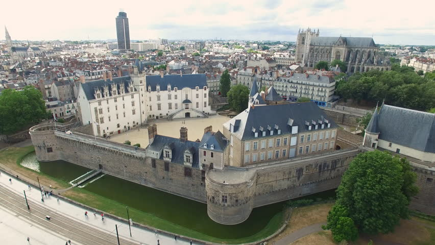 Aerial view of cityscape of Nantes, fort Chateau de Nantes, famous Cathedral of St. Peter and St. Paul in background - Normandy, France, 4k UHD