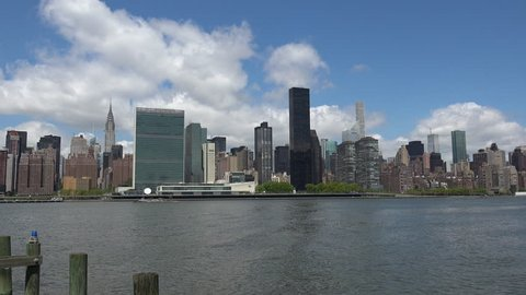 Viewing beautiful breathtaking Manhattan Skyline from Long Island City in New York, wide shot panorama with ONU,United Nations Headquarters,Ultra Hd 4k, real time