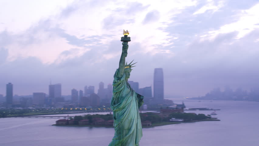 New York City circa-2017, Aerial orbit of Statue of Liberty at sunrise. Shot with Cineflex and RED Epic-W Helium. | Shutterstock HD Video #28500217
