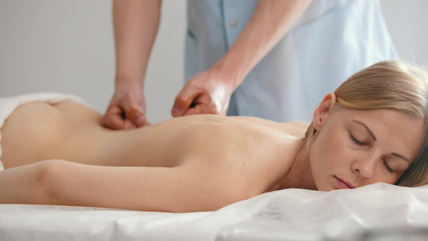 Relaxation Massage For Back Man Rmassaging For Young Blonde Female