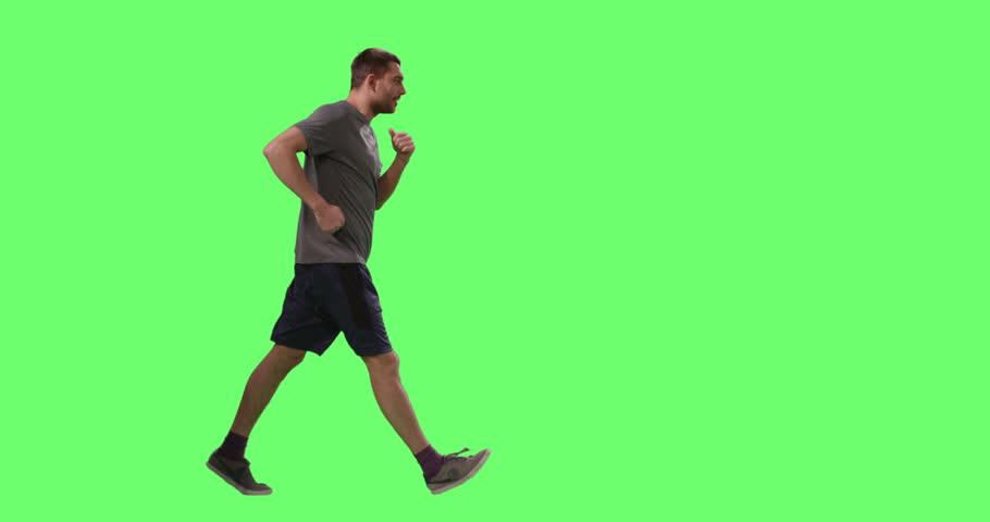 Man in a T-shirt is Sport Walking on a Mock-up Green Screen in the Background. Shot on RED Cinema Camera in 4K (UHD).