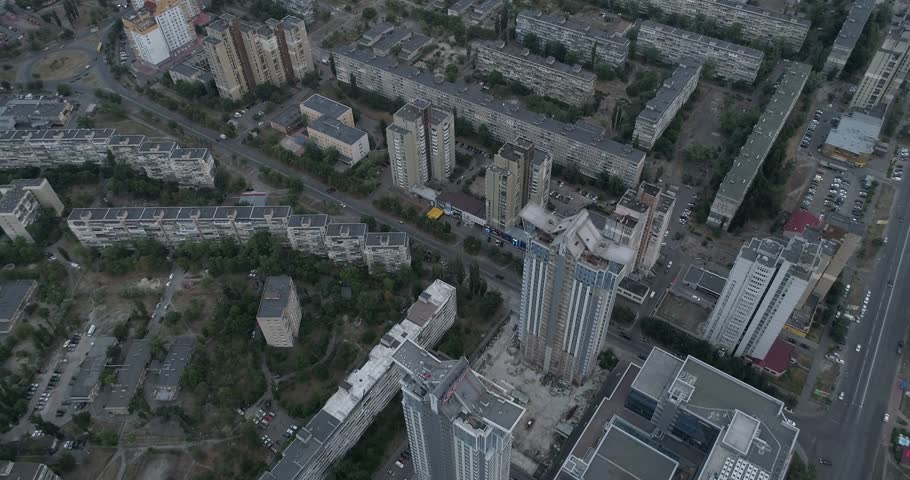Ukraine. Kiev. July 3, 2017. The Paton Bridge. 4K video. Aerial photography.. Building. Trees. Movement of the drone directly, the camera is directed below the middle. | Shutterstock HD Video #28552168