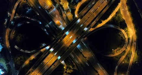 Aerial, traffic in bangkok at kanjanapisek road beside rama 2 road with top view of drone on night time.