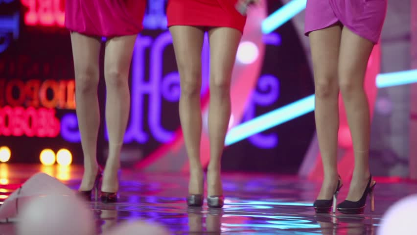 Three girls dance on stage with word LOVE on screen, only legs are visible #2859688
