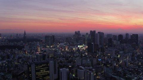 Japan Tokyo Aerial v64 Flying over Shinjuku area panning with cityscape views at dusk 2/17