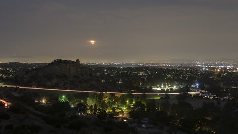 Los Angeles moonrise dusk to night time lapse behind Stoney Point Park in the San Fernando Valley area of Southern California.