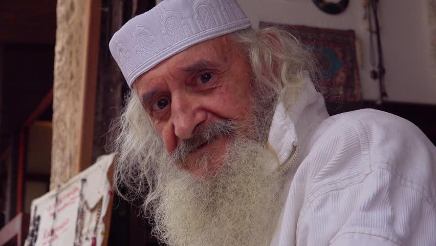 Bosnia Herzegovina-2010s: An old Bosnian Muslim man looks at the camera. | Shutterstock HD Video #28639228