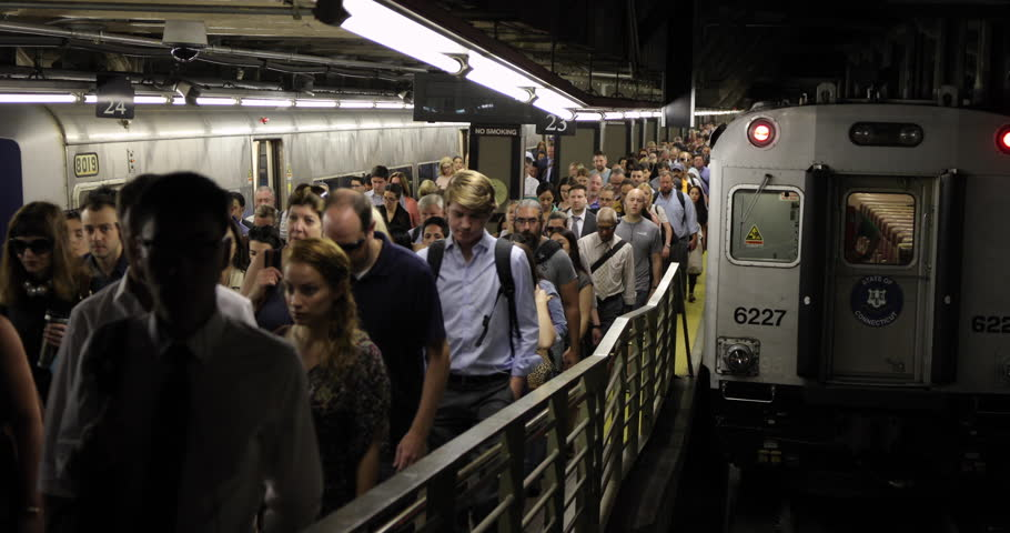 NEW YORK - CIRCA JULY 2017: Crowd of morning commuters people getting off train #28674418