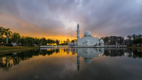 Floating Mosque With Fast Moving Clouds during sunrise, Timelapse. Mosque Tengku Tengah Zaharah also known as Floating Mosque in Kuala Terengganu, Malaysia with perfect reflection. Pan Motion.