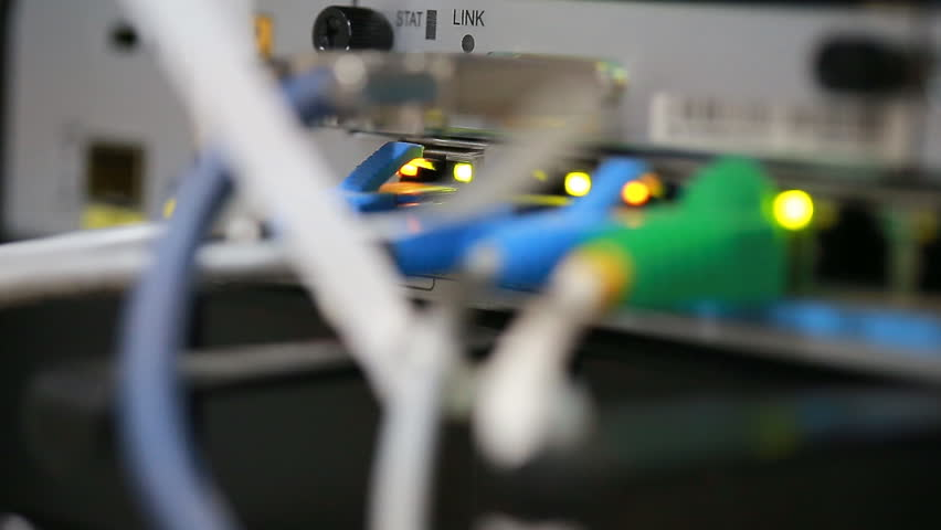 Technology center network server room with UTP Network cables connected to an Fast/Giga ethernet ports. Internet Service Provider equipment. Focus on UTP cables. Data Network Hardware Concept.