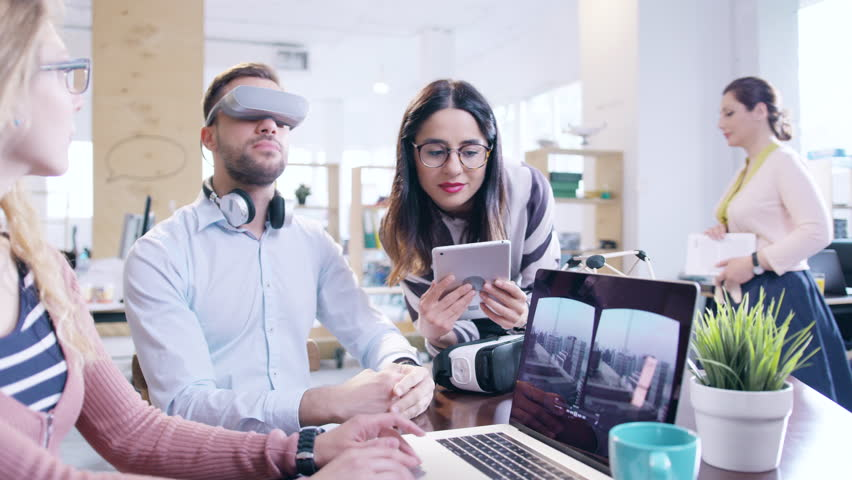Trendy Designers Wearing Virtual Reality Vr Headset Glasses Teamwork Startup Innovation Testing Augmented Reality Headset Programming AR Vr Application Creating Virtual Reality Applications Innovative