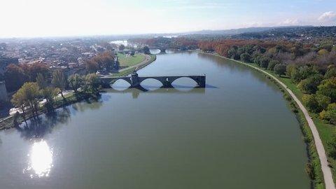 AVIGNON  FRANCE  NOV 2016 - AERIAL VIDEO OF THE AVIGNON BRIDGE CALLED BRIDGE SAINT-BENEZET WITH A BEAUTIFUL LIGHT AND ORIGINAL ORIENTATION