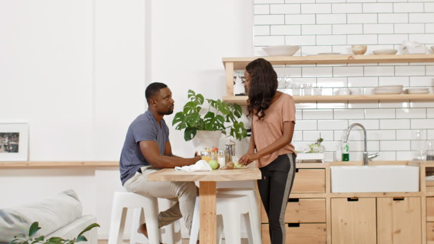 Loving couple eating breakfast in kitchen, woman feeding husband | Shutterstock HD Video #28728238